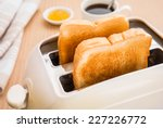 Bread Slices In Toaster With...