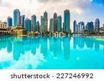 dubai skyline at dusk  uae.   Shutterstock . vector #227246992
