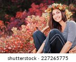 beautiful young woman with... | Shutterstock . vector #227265775