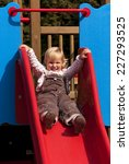 happy little girl on slide | Shutterstock . vector #227293525