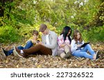 friends sitting in the park | Shutterstock . vector #227326522