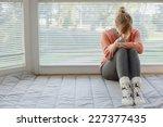 woman is having headache  she... | Shutterstock . vector #227377435