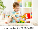 kid boy playing with building... | Shutterstock . vector #227386435
