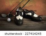 Golf Shoes With Golf Clubs On...