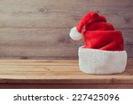Santa Hat On Wooden Table With...