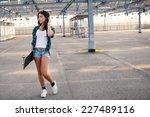 teenager walking with... | Shutterstock . vector #227489116