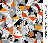 Triangle seamless pattern. Vector illustration. Contrasting fashionable polygonal backdrop with black and orange panes. Beautiful geometric design for various craft projects.