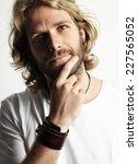 blond man touching his beard   Shutterstock . vector #227565052