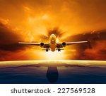 Passenger Jet Plane Flying Over ...