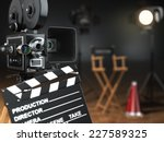 Video, movie, cinema concept. Retro camera, flash, clapperboard and director's chair in dark studio with dof effect. 3d - stock photo