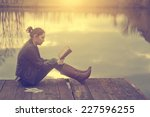 woman reading in sunset | Shutterstock . vector #227596255
