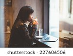 young woman drinking coffee in... | Shutterstock . vector #227606506