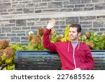 Man Waiving To Somebody From A...