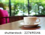 Small photo of cup of coffee on table in cafe ,Morning light