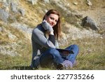 woman using a tablet in a cold... | Shutterstock . vector #227735266