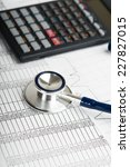 health care costs. stethoscope... | Shutterstock . vector #227827015