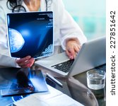 close up of doctors hands... | Shutterstock . vector #227851642