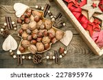 Постер, плакат: walnuts with christmas decorations