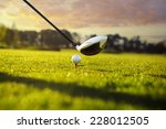 golf ball on tee in front of...   Shutterstock . vector #228012505