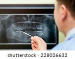 dentist looking teeth on... | Shutterstock . vector #228026632