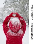 Woman Making Heart Symbol With...