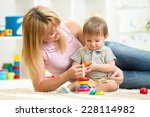 happy mother and child son... | Shutterstock . vector #228114982
