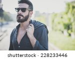 young handsome attractive... | Shutterstock . vector #228233446