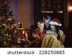 Lovely Family Sharing A Digital ...