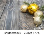 christmas baubles  on a rustic... | Shutterstock . vector #228257776