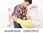 man cleaning toilet with spray... | Shutterstock . vector #228315412