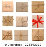 brown parcels isolated | Shutterstock . vector #228343312