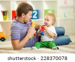 happy family dad and son play...   Shutterstock . vector #228370078