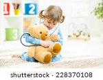 cute kid girl playing doctor... | Shutterstock . vector #228370108