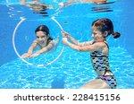 happy active kids swim in pool... | Shutterstock . vector #228415156