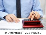 businessman calculating  and... | Shutterstock . vector #228440362
