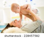 mother and baby hugging and... | Shutterstock . vector #228457582