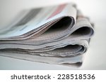 four folded newspapers | Shutterstock . vector #228518536