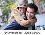 man giving piggyback ride to... | Shutterstock . vector #228568408