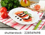 eggplant salad with tomatoes... | Shutterstock . vector #228569698
