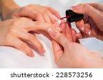 manicure in the spa salon.... | Shutterstock . vector #228573256