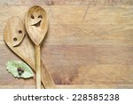 wooden kitchenware on cutting... | Shutterstock . vector #228585238