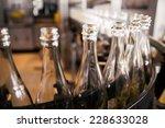 bottles on the conveyor belt | Shutterstock . vector #228633028