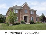 brick suburban home with arched ... | Shutterstock . vector #228664612