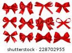 Shiny red satin ribbon on white ...
