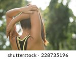 rear view of woman stretching... | Shutterstock . vector #228735196
