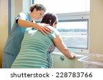 mid adult female nurse... | Shutterstock . vector #228783766