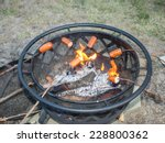 roasting sausages on wooden... | Shutterstock . vector #228800362