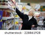 elderly woman choosing dairy... | Shutterstock . vector #228861928