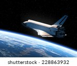 space shuttle orbiting earth.... | Shutterstock . vector #228863932