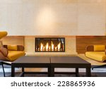modern fireplace sitting area... | Shutterstock . vector #228865936